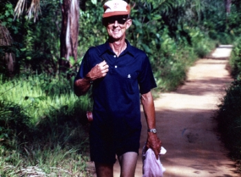 Dad walking to the Ethiope River, in Clemson cap